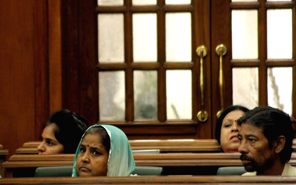 The parents of Meenakshi, who was stabbed to death by a youth on July 16th, 2015 in Anand Parbat of Delhi; at the state legislative assembly on the Day 1 of the monsoon session of the ...