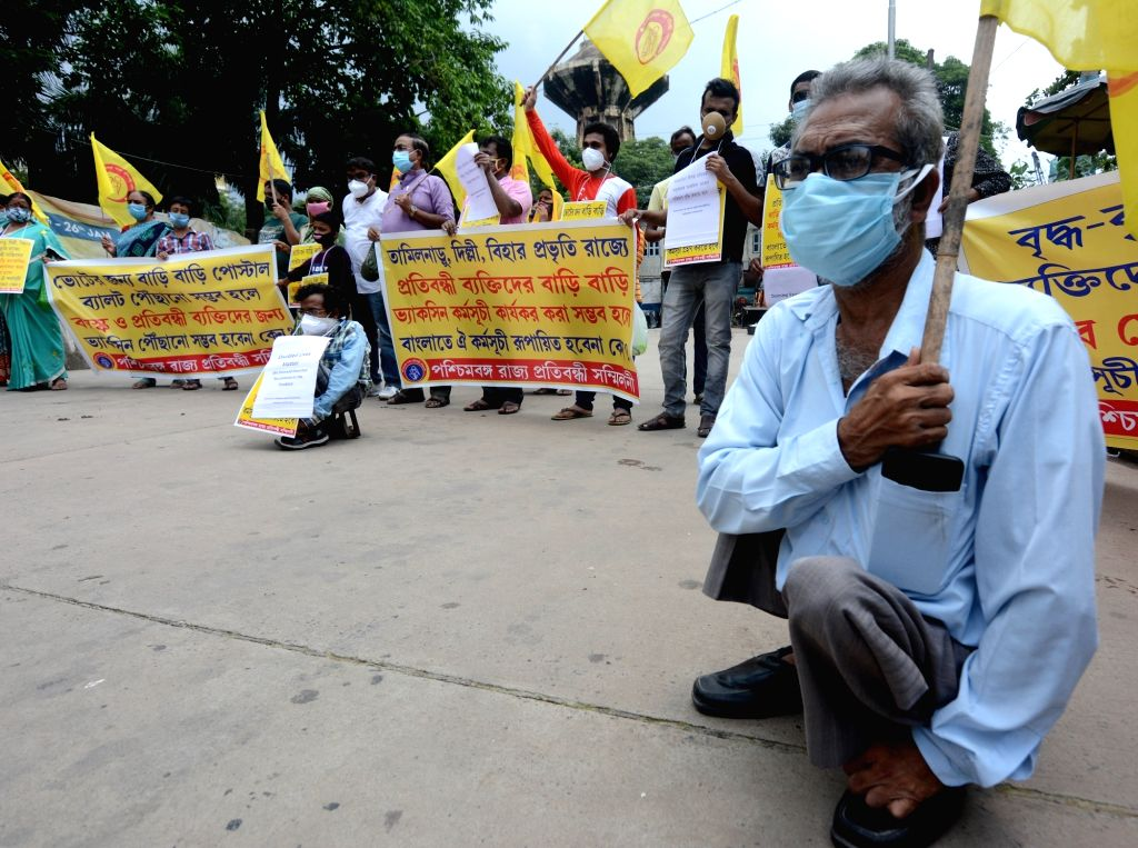 The persons with a disability take part in protest rally against State Governmentand and demand for their Doorstep Vaccination in Kolkata on Wednesday, June 23, 2021.