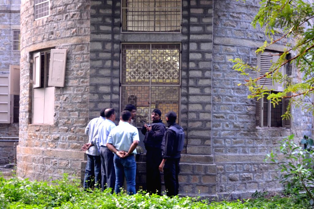 The police and the Garuda Force (Anti-Terror Squad) personnel at National Institute of Mental Health and Neurosciences (NIMHANS) where a 22-year-old prisoner under-treatment, snatched a ...
