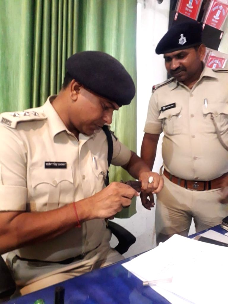 The police investigates a country made pistol detained by the CISF from a Delhi-bound passenger who was detained after he was found carrying the pistol inside a tiffin box, at Jay Prakash ...