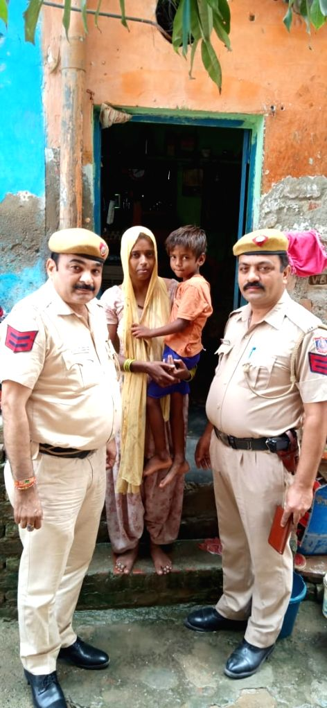 The policemen who rescued a child from a drain in New Delhi.