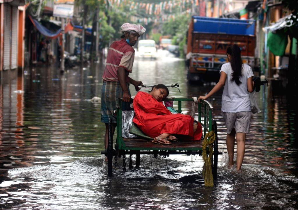The poor sick woman left the cycle van and went to the hospital wade through a waterlogged road during heavy rain in Kolkata on Thursday 17 June 2021.