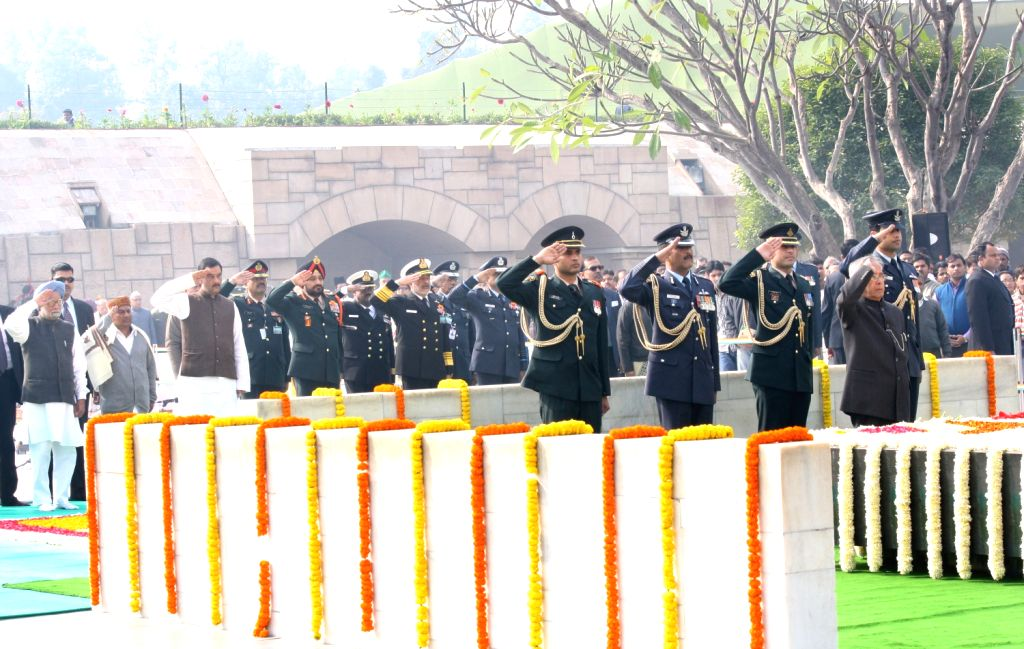 The President of India Pranab Mukherjee paying tributes at the Samadhi of Mahatma Gandhi on the occasion of Martyr`s Day in Rajghat, New Delhi.