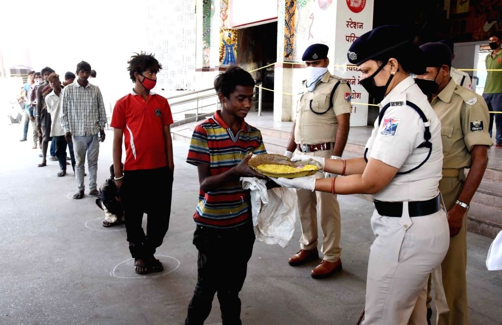 The Railway Protection Force (RPF) personnel distribute food among the poor and the needy at the Patna Junction Railway Station on Day 5 of the 21-day countrywide lockdown imposed to contain ...