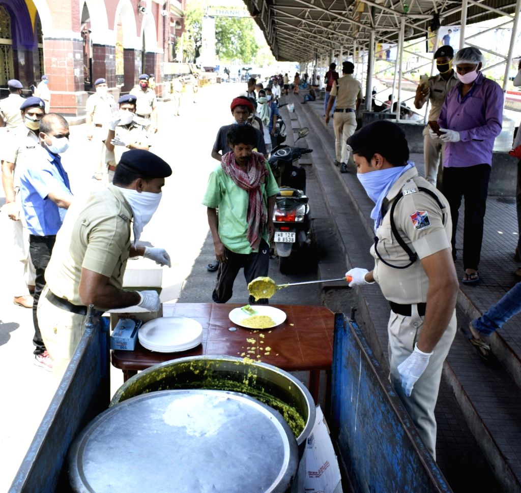The Railway Protection Force (RPF) personnel distribute food among the poor on Day 5 of the 21-day countrywide lockdown imposed to contain the spread of novel coronavirus, in Kolkata on ...
