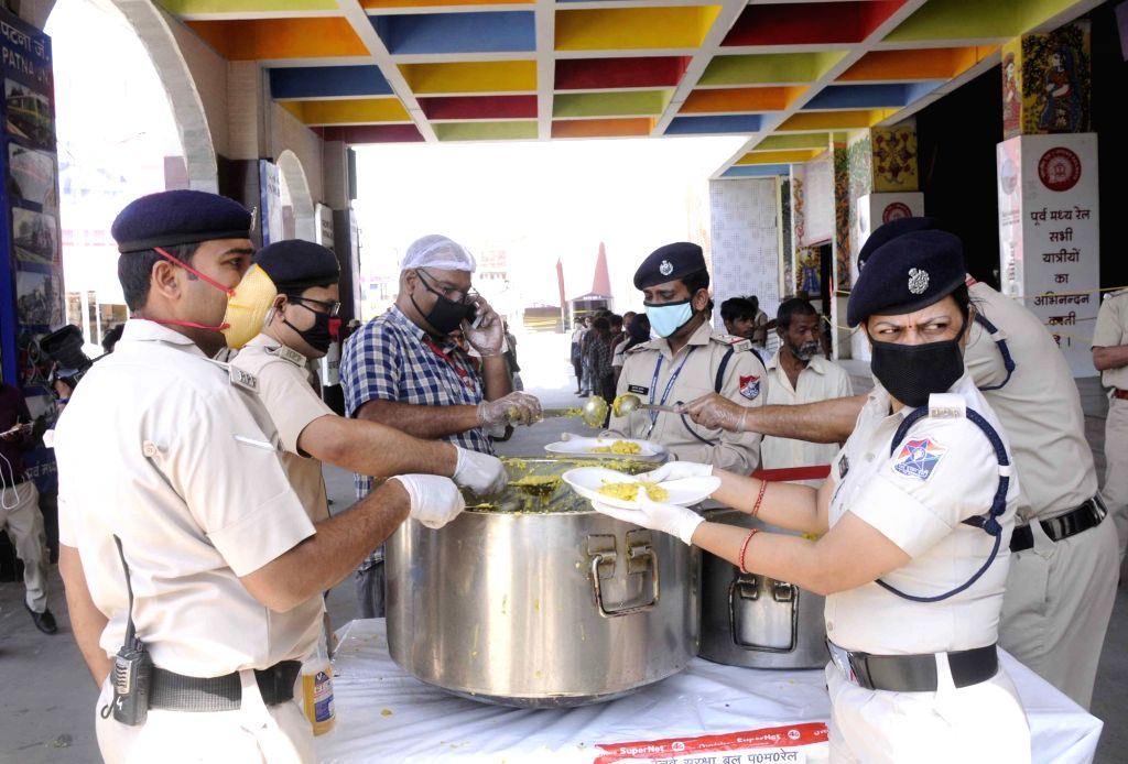 The Railway Protection Force (RPF) personnel distribute food among the poor, needy and homeless on Day 6 of the 21-day nationwide lockdown imposed to contain the spread of coronavirus, at the ...