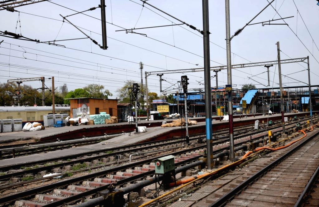The railway tracks at the New Delhi Railway Station bear a deserted look on Day 2 of the 21-day nationwide lockdown imposed by the Narendra Modi government over the coronavirus pandemic; ... - Narendra Modi