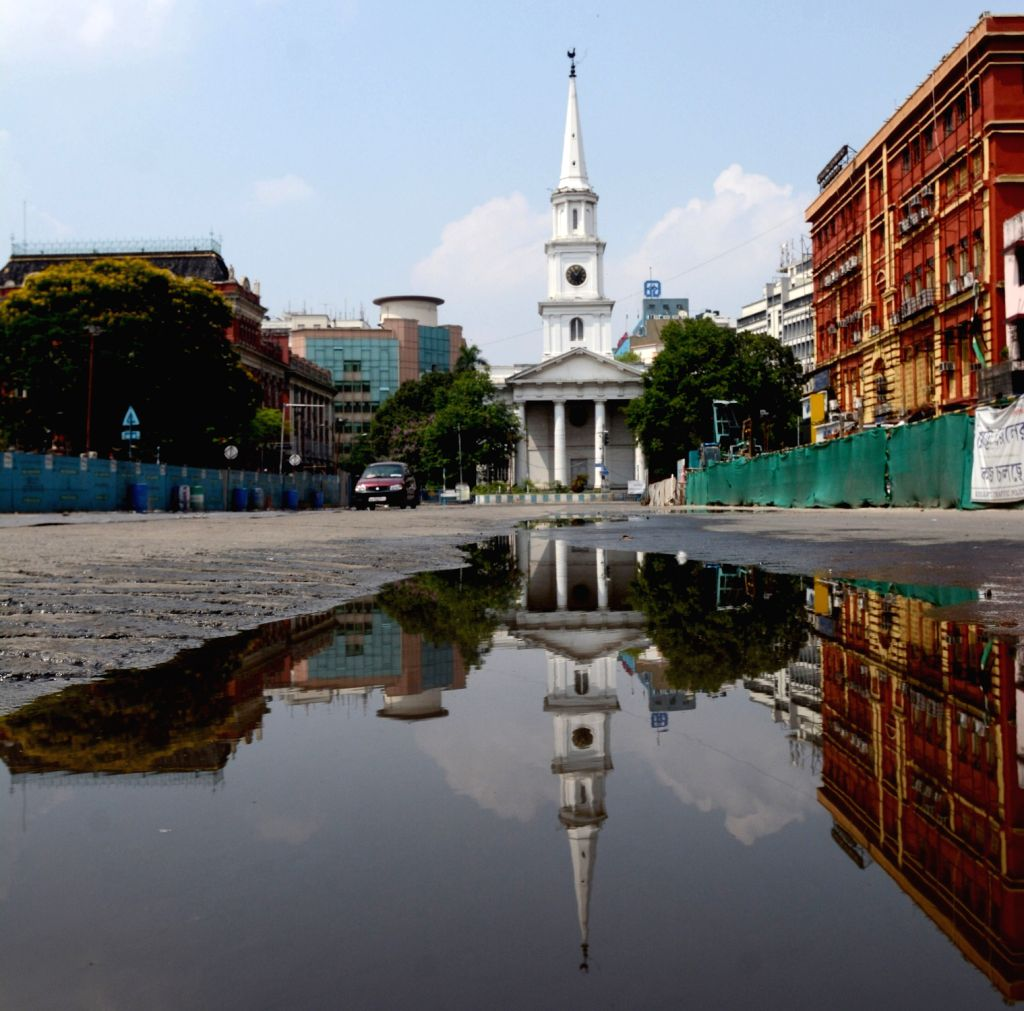 The reflection of a church seen in the rainwater accumulated at an adjacent deserted street in Kolkata afte rains lashed the city on May 6, 2020.