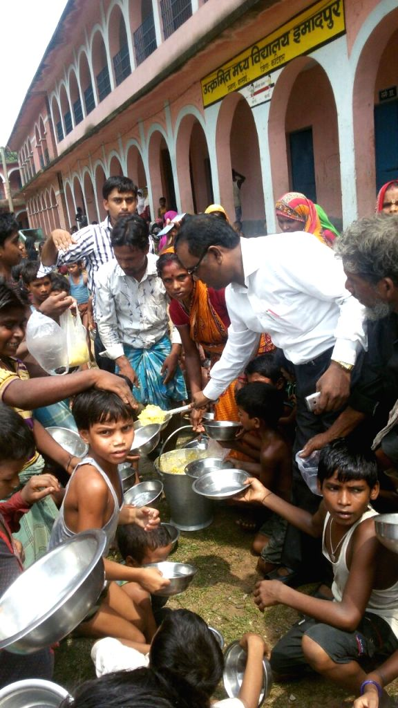The relief food being distributed to the people those affected by the floods on July 30, 2016.