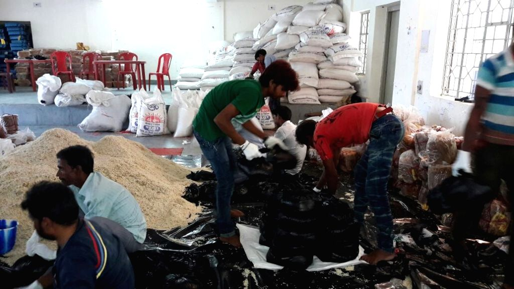 The relief food packets are being packed for the people those affected by the floods on July 30, 2016.