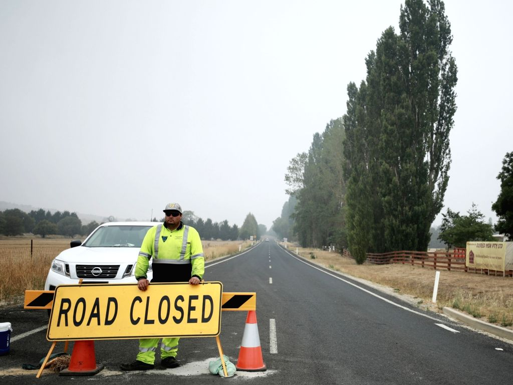 The road from Braidwood to Batemans Bay is blocked in Braidwood in the southeast of Australia, Jan. 8, 2020. If without the bushfires, Braidwood in the southeast ...