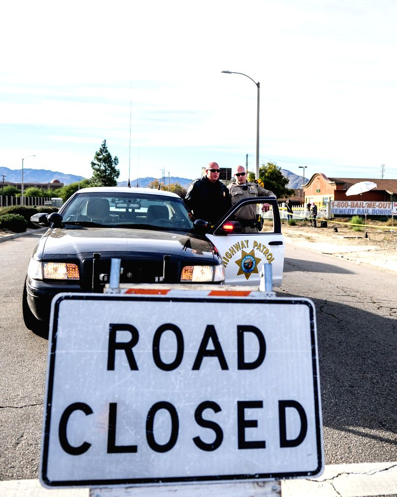 The road remains closed near the Inland Regional Center in San Bernardino, California, on Dec. 3, 2015. Police continue to investigate a mass shooting at the ...