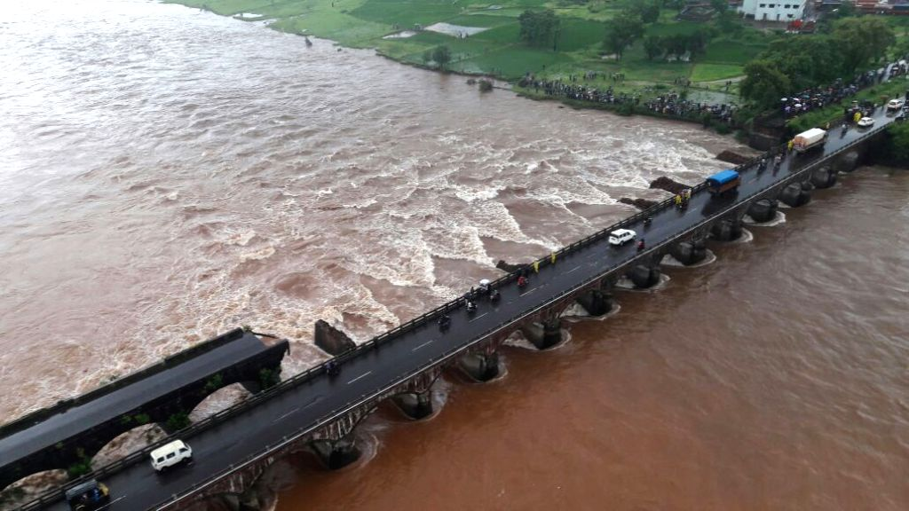 The scene at a bridge collapse in Maharashtra where 22 bus passengers are missing