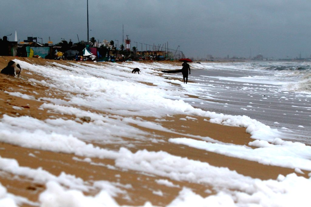 The sea shore of Marina Beach filled with foam, in Chennai on Oct 30, 2019.