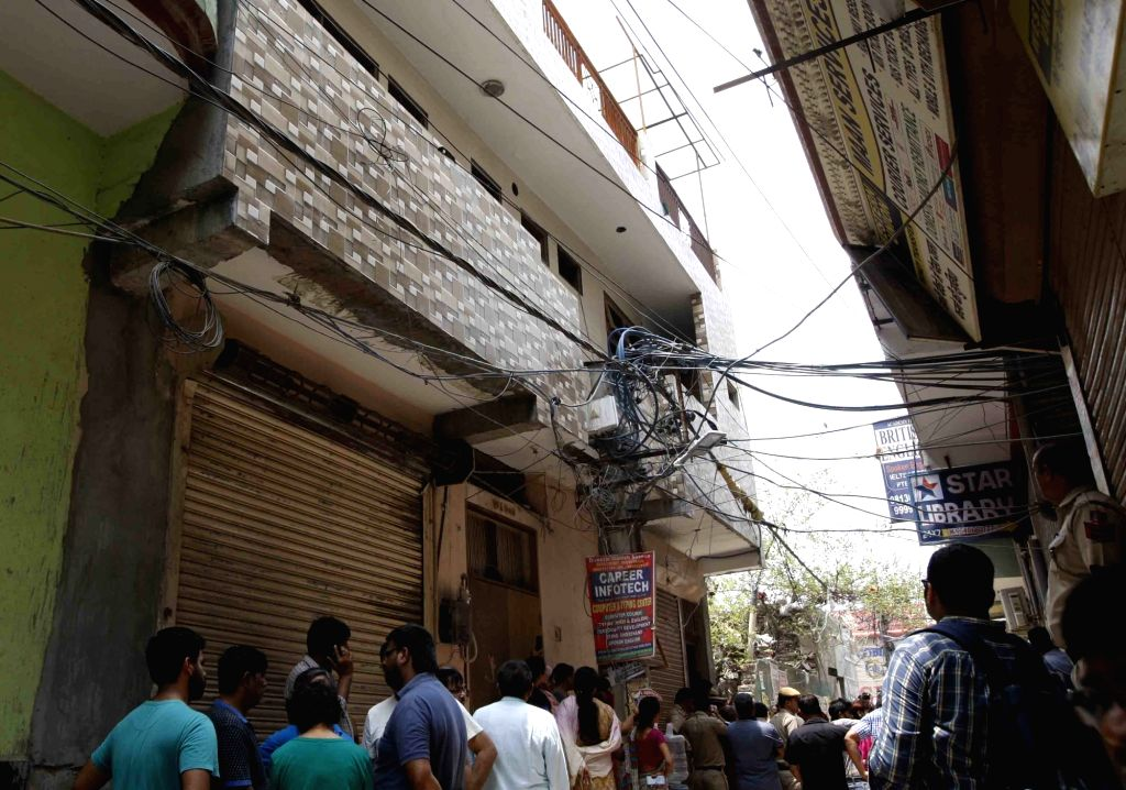 The site where 11 members of a family were found deadsome blindfolded and hanging from an iron grill ceilingat their home, in New Delhi on July 1, 2018. According to Joint ...