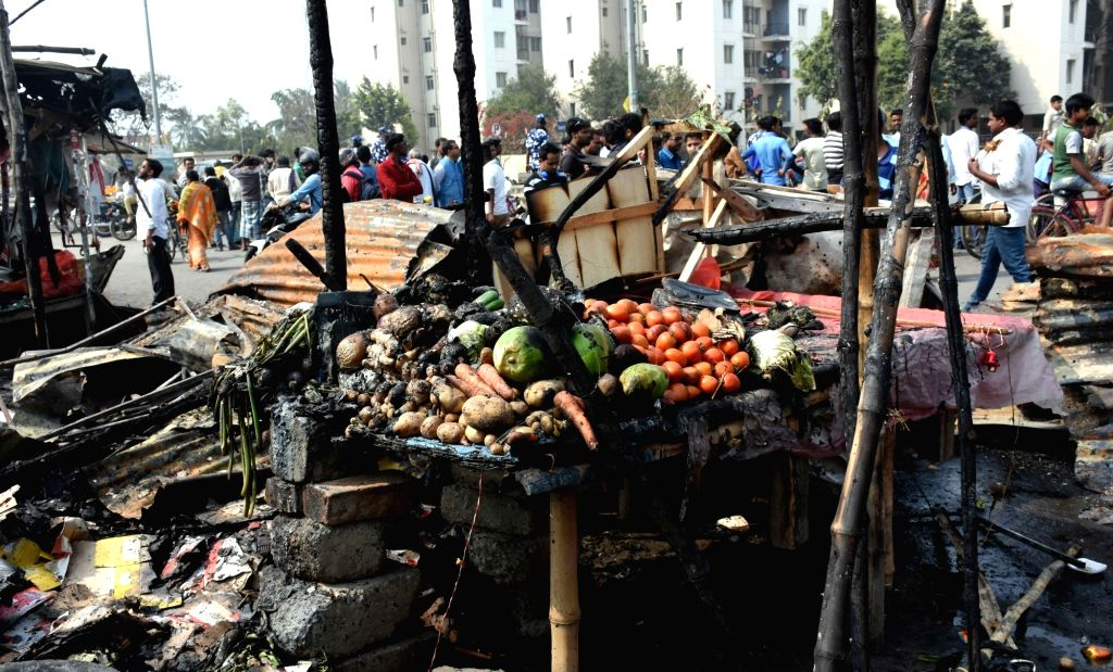 The site where a fire broke out in the New Town area of Kolkata, on Feb 7, 2019. Two persons, including a fire-fighter, received minor burn injuries. Few temporary shops opposite the ...