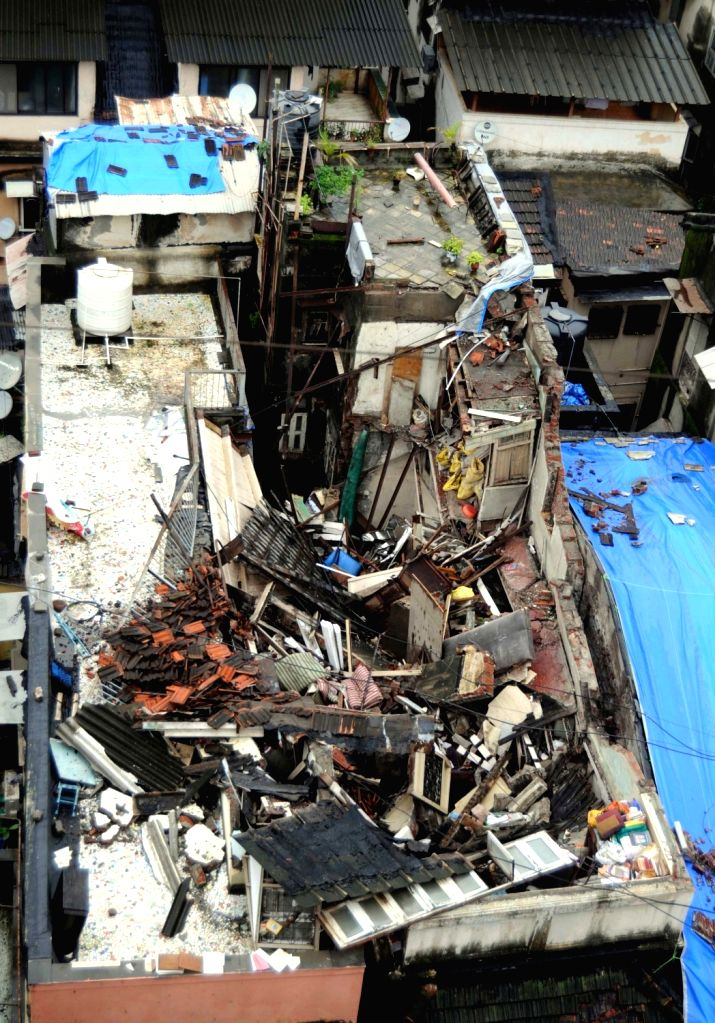 The site where a portion of a three-storied building collapsed on the adjacent building, trapping three persons in the debris; at Girgaon in Mumbai on July 30, 2016.