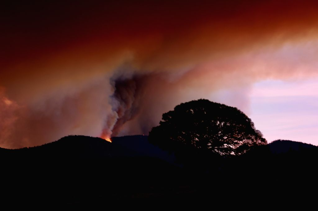 The sky over the Namadgi National Park turns red due to a bushfire in Canberra, Australia, Jan. 28, 2020.   A bushfire in the south of Canberra is recognized as ...