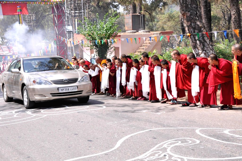 The spiritual head of Tibetan Buddhist Dalai Lama being welcomed in Dharamsala after as he returns from his Europe tour on May 17, 2014.