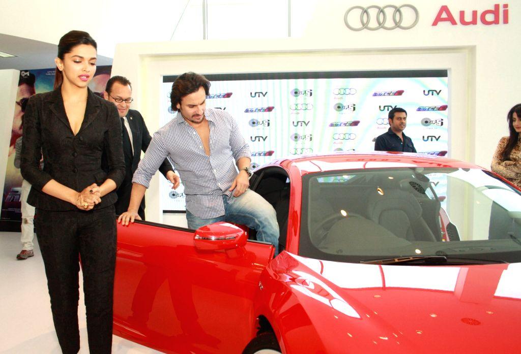 The star cast of film Race 2, Deepika Padukone, Saif Ali Khan at the Audi Showroom,in New Delhi.(Photo:IANS/Amlan) - Deepika Padukone and Saif Ali Khan