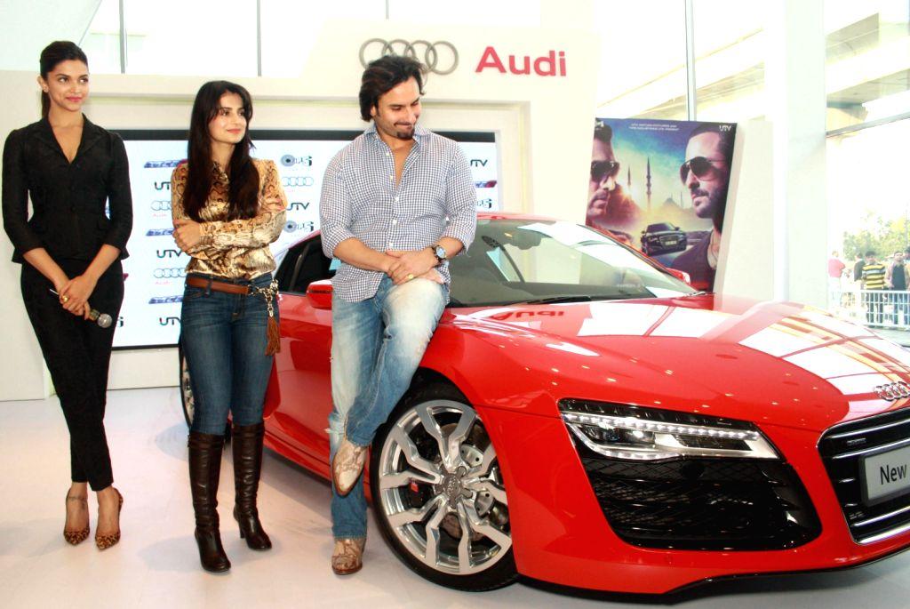 The star cast of film Race 2, Deepika Padukone, Saif Ali Khan and Ameesha Patel at the Audi Showroom,in New Delhi.(Photo:IANS/Amlan) - Deepika Padukone, Saif Ali Khan and Ameesha Patel