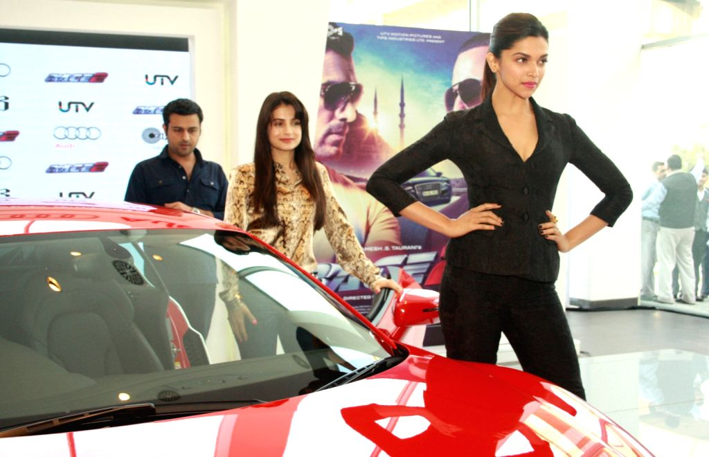 The star cast of film Race 2, Deepika Padukone and Ameesha Patel at the Audi Showroom,in New Delhi.(Photo:IANS/Amlan) - Deepika Padukone and Ameesha Patel