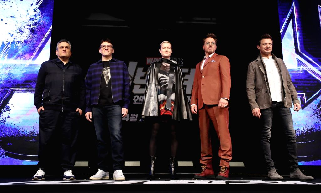"""The stars of the new movie """"Avengers: Endgame""""Brie Larson, Robert Downey, Jr., Jeremy Renner (C to R) along with directors Joe Russo (L) and Anthony Russo (2nd L)pose for a ..."""