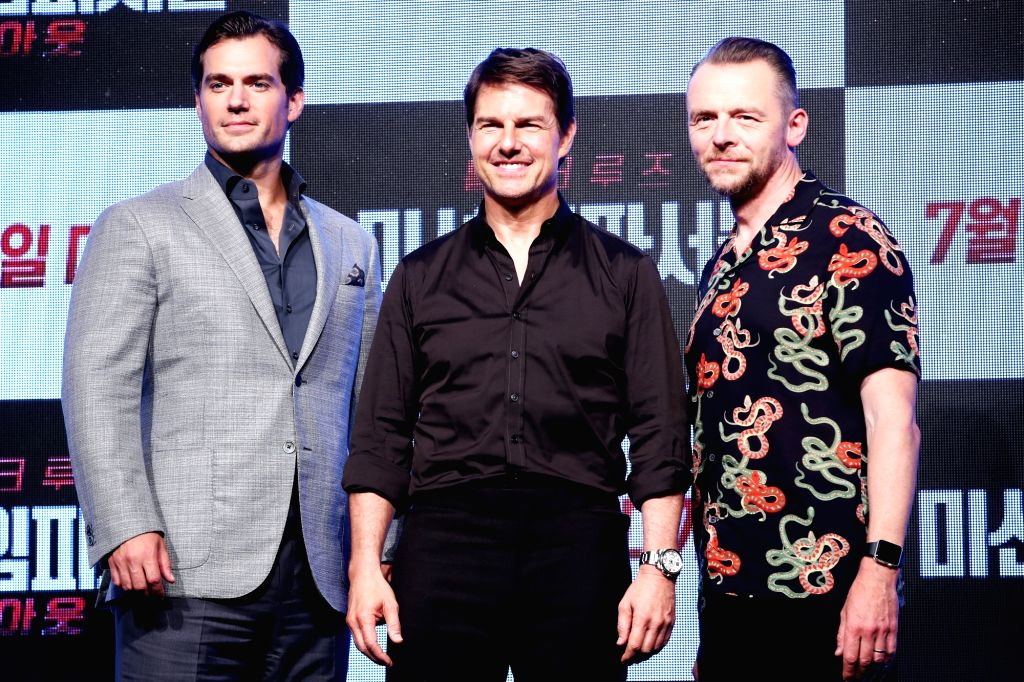 """The stars of the new movie """"Mission: ImpossibleFallout""""Henry Cavill, Tom Cruise and Simon Pegg (L to R)pose for a photo during a publicity event in Seoul on July 16, ..."""