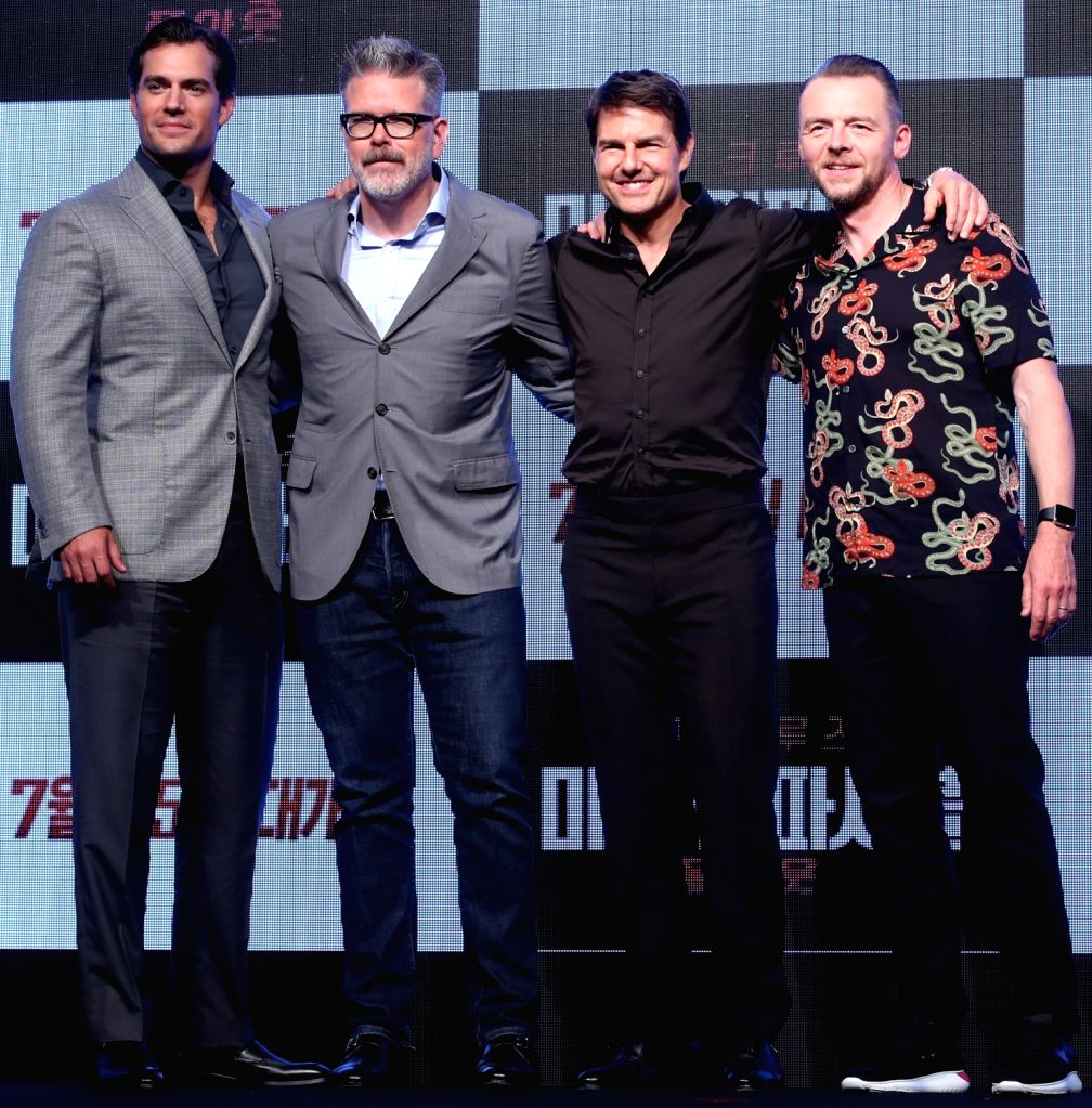 """The stars of the new movie """"Mission: ImpossibleFallout""""Henry Cavill, Tom Cruise and Simon Pegg (L to R)along with director Christopher McQuarrie (2nd L)pose for a ... - Christopher M"""