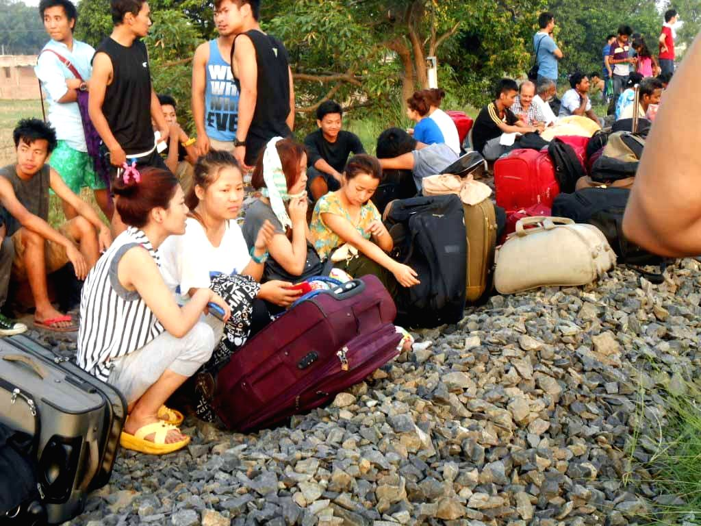The stranded passengers of Delhi-Dibrugarh Rajdhani Express which was derailed near Goldenganj railway station in Bihar's Saran district on June 25, 2014. At least four people were killed and eight ..