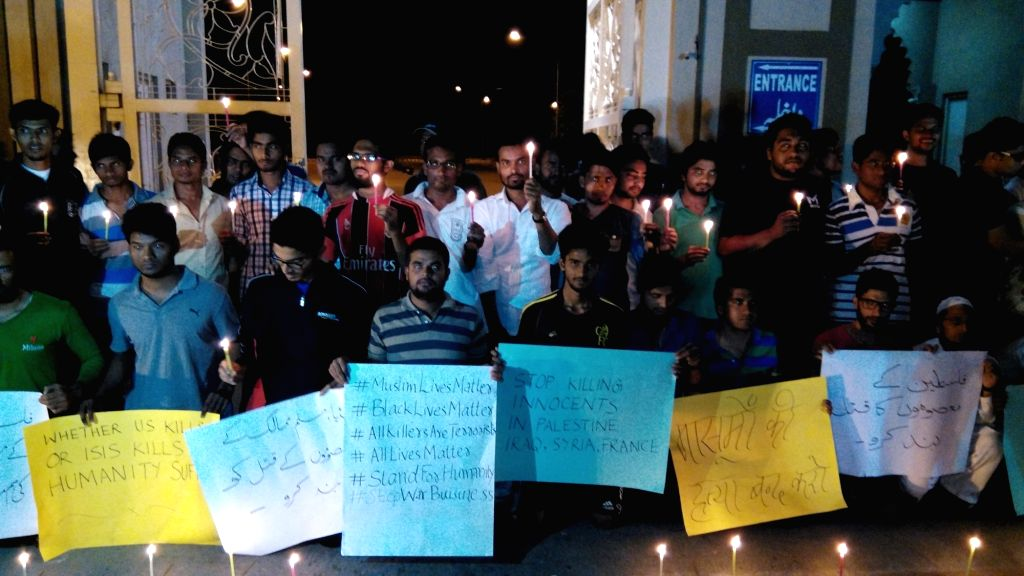 The students of Maulana Azad National Urdu University stage a demonstration to condemn the 13/11 Paris blasts in Hyderabad, on Nov 16, 2015.