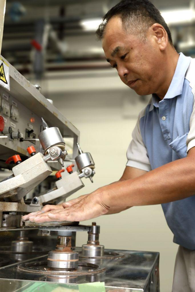 "The  ""Takumi"" or senior architect Toshio Saito is seen at work at Canon's Utsunomiya facility."