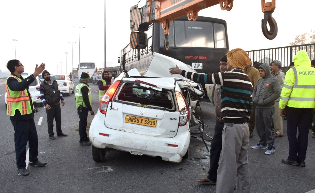 The taxi that rammed into a stationary National Security Guard (NSG) bus on the Delhi-Gurugram Expressway being removed, in Gurugram on Jan 27, 2019. Two people travelling in the taxi were ...