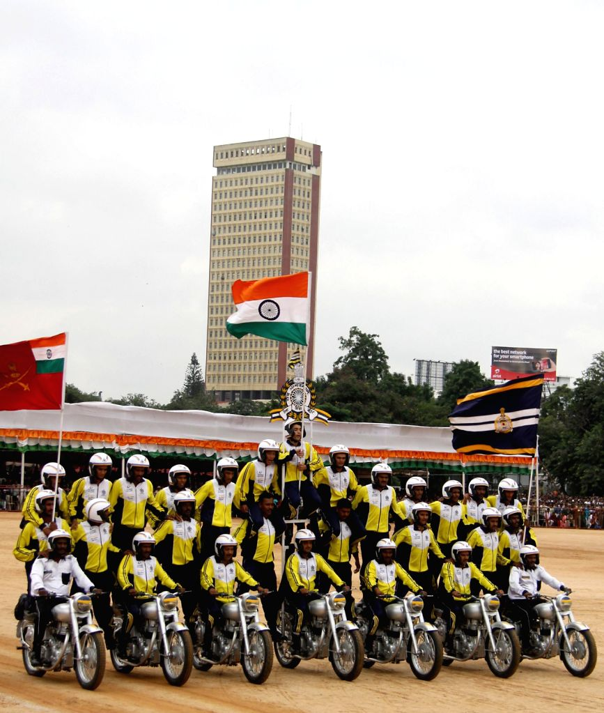 The team of Military Police performs bike stunts during Independence Day Parade at Manekshaw Parade Grounds , in Bangalore on Thursday 15th August 2013. (Photo::: IANS)