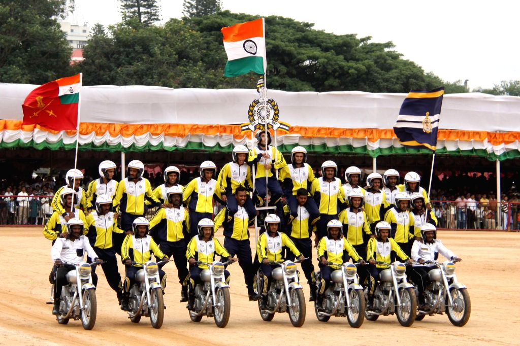 The team of Military Police performs bike stunts during Independence Day Parade at Manekshaw Parade Grounds in Bangalore on Thursday 15th August 2013. (Photo::: IANS)