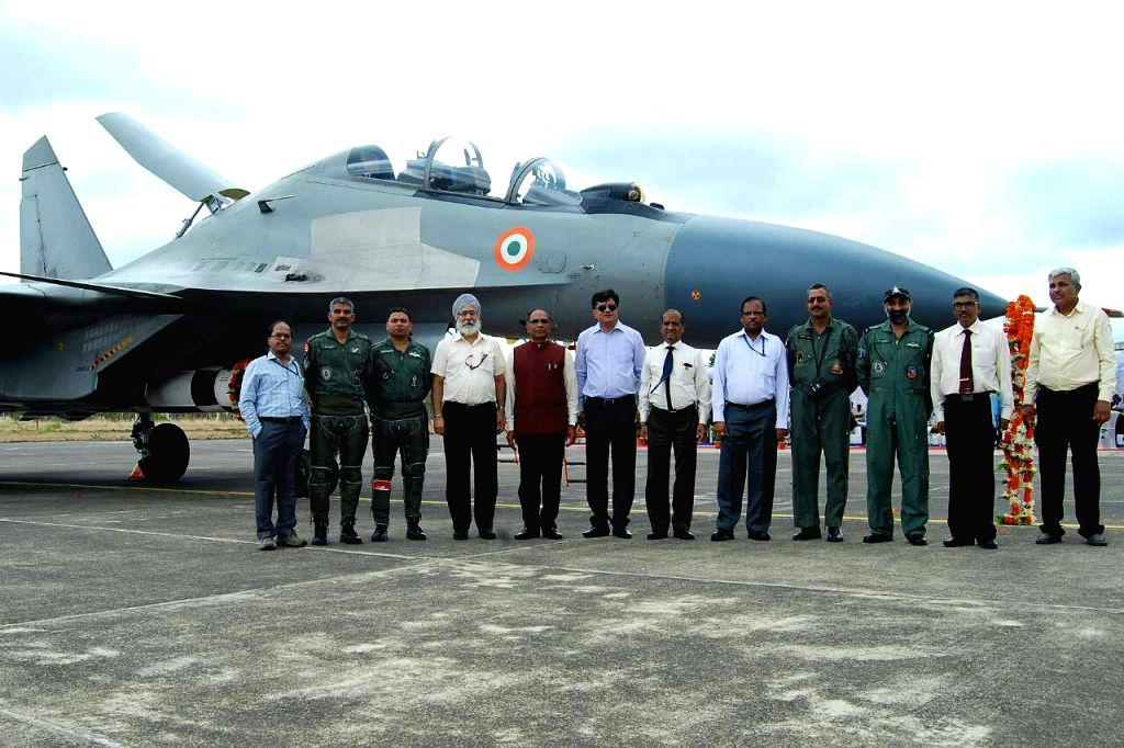 The team with the aircraft in background.