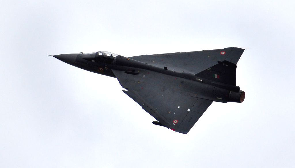The Tejas Light Combat Aircraft (LCA) fly on its first sortie during its induction ceremony at HAL, in Bengaluru on July 1, 2016.