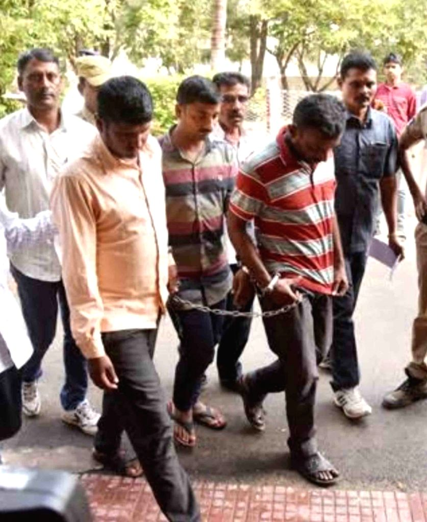 The three accused of gang-raping and murdering a woman in Telangana, being taken to be produced at a court in Adilabad on Jan 30, 2020. All the three were sentenced to death in the ...