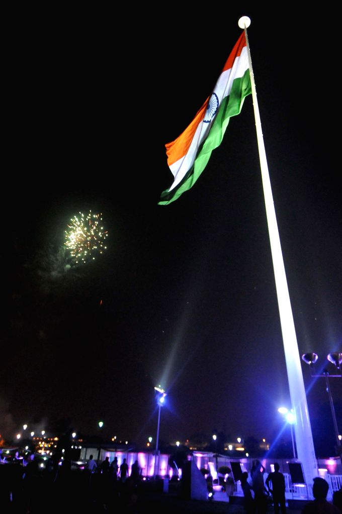 The tricolour waves amidst fireworks during the inauguration of Independence Day Celebrations organised by Flag Foundation of India and New Delhi Municipal Council at Central Park in Connaught Place .