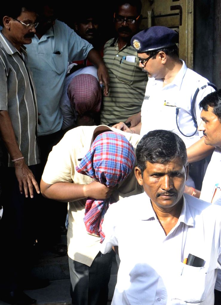 The two men who shot at a policeman being taken to be produced before a Kolkata court on April 19, 2015.