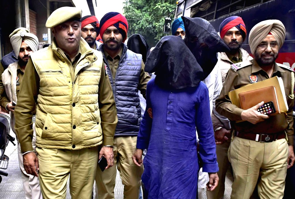 The two men who were arrested by Punjab Police in connection with gang-rape a 21-year-old woman being taken to be produced in a Ludhiana court on Feb 13, 2019.