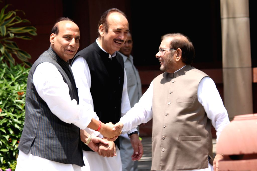 The Union Home Minister Rajnath Singh, Congress leader Ghulam Nabi Azad and JD(U) chief Sharad Yadav arrive to attend an all party meeting at Parliament House in New Delhi on Aug 3, 2015. - Rajnath Singh and Sharad Yadav