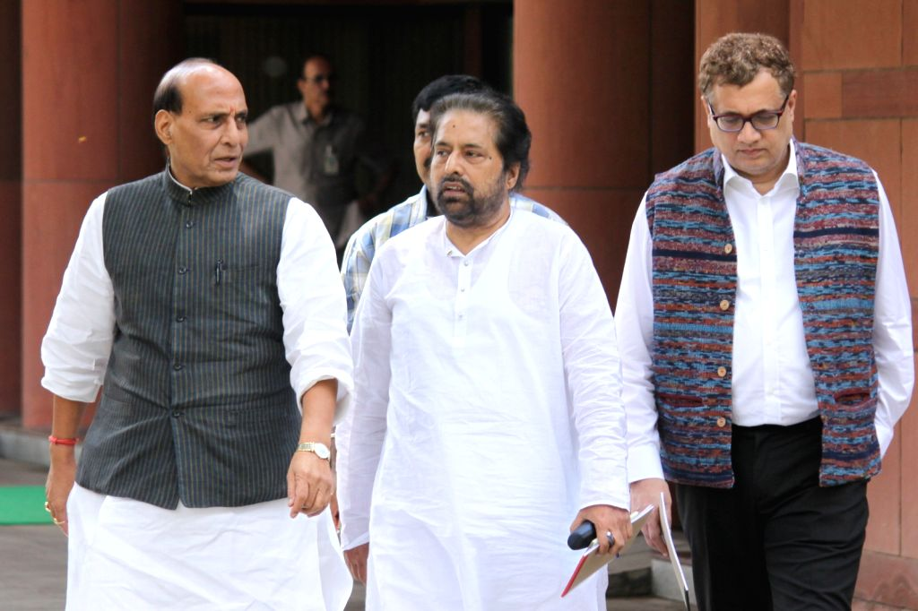 The Union Home Minister Rajnath Singh, Trinamool Congress MPs Sudip Bandyopadhyay and Derek O'Brien after an all party meeting at Parliament House in New Delhi on Aug 3, 2015. - Rajnath Singh