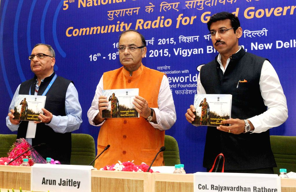 The Union Minister for Finance, Corporate Affairs, and Information and Broadcasting Arun Jaitley releases a book at the 5th National Community Radio Sammelan, in New Delhi on March 16, 2015. Also ... - Rajyavardhan Singh Rathore