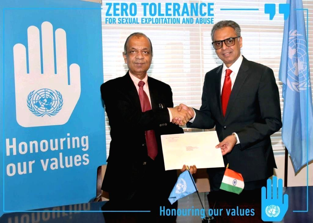 :The United Nations Under-Secretary-General for Field Operations, Atul Khare, left, receives India's contribution of $300,000 from India's Permanent Representative Syed Akbaruddin. The ...