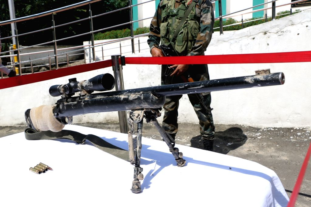 The US made sniper rifle M24 that was recovered by security forces during raids at terror hideouts along the Amarnath Yatra route, in Srinagar on Aug 2, 2019. Security forces had recovered ...
