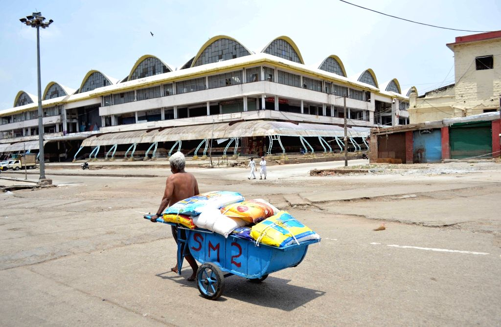 The ususally busy KR Market in Bengaluru bears a deserted look during the extended nationwide lockdown imposed to mitigate the spread of coronavirus, on May 6, 2020.