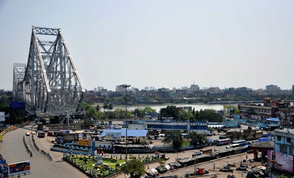 The ususaly busy Howrah Bridge and adjoining areas in Kolkata bear a deserted look during a nationwide shutdown - Janata Curfew - called by Prime Minister Narendra Modi as a measure to ... - Narendra Modi