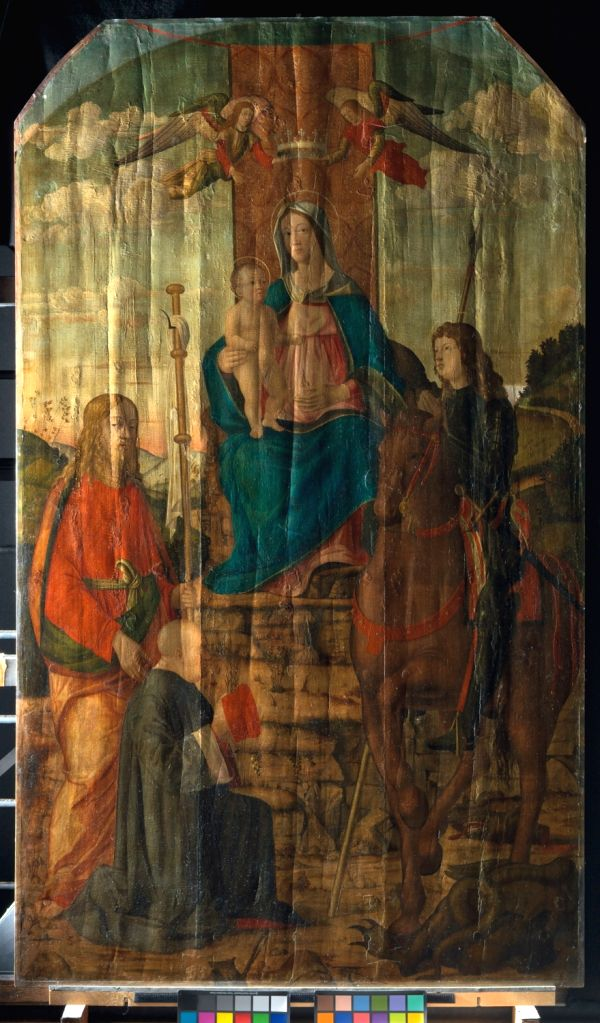 The Virgin and Child with Saints by Giovanni Martini da Udine shown in raking light before cleaning, structural treatment and restoration.