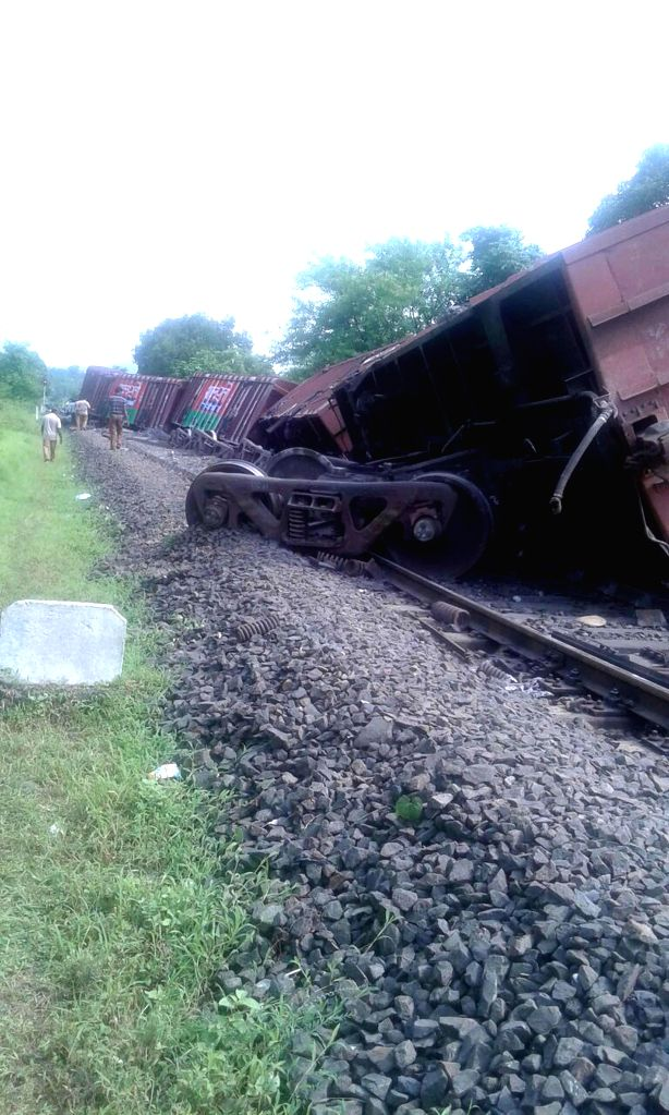 The wagons of the Kota-Calicut train carrying a consignment of foodgrain which were derailed at Karanjadi, around 200 kms south of Mumbai, on Aug 24, 2014.
